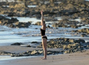 miley_cyrus_bikini_candids_doing_yoga__in_hawaii_24